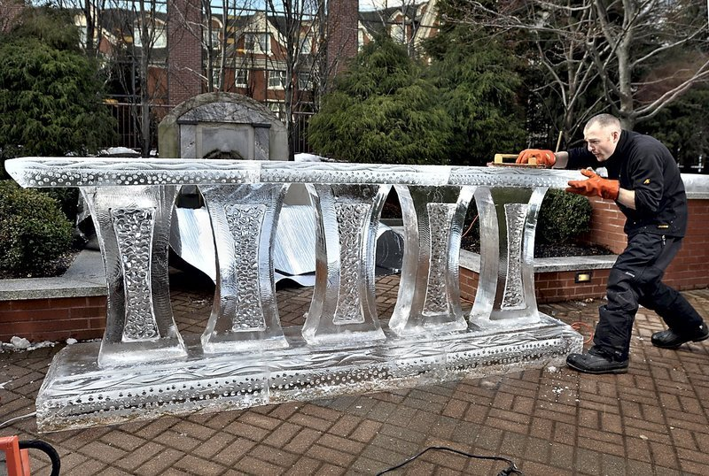 Earl Morse puts the finishing touches on the ornate base of Portland Harbor Hotel's ice bar in 2010.