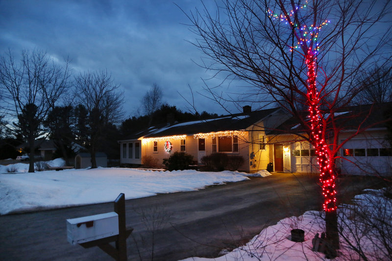 Lights were still shining brightly Tuesday on View Street in Brunswick. Despite rumors to the contrary, Maine has no laws regulating when holiday displays must be taken down.