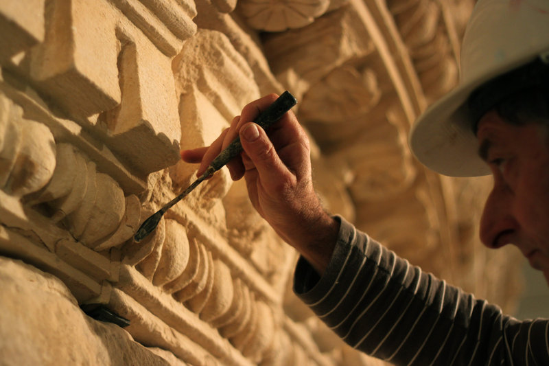 A restorer at Israel's national museum in Jerusalem works Tuesday on what curators say is King Herod's reassembled tomb. The show will open Feb. 12.