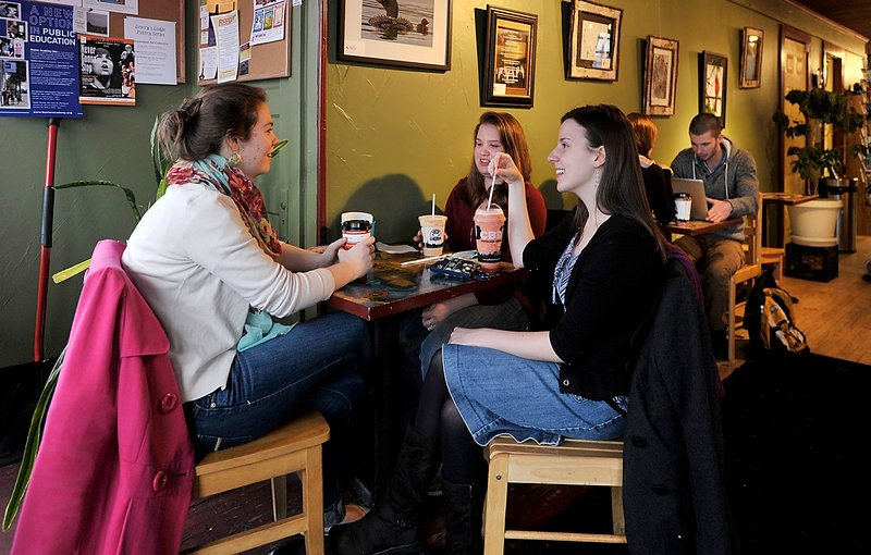 From left, junior Karianna Merrill, freshman Allie Macisso and sophomore Brittany Getch, regulars at the Gorham Grind coffee shop, relax after classes at USM-Gorham. Gorham shops would like to attract a before-class crowd, too.