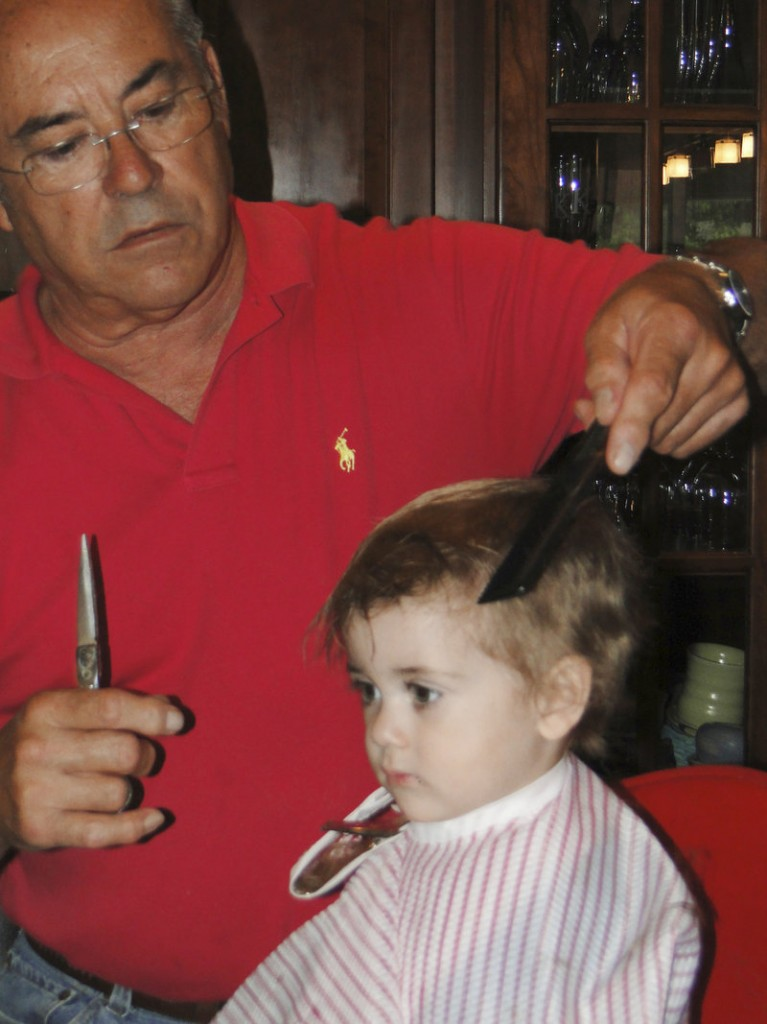 Jim Rogers cuts the hair of his grandson, Jason Kinsella in 2011.