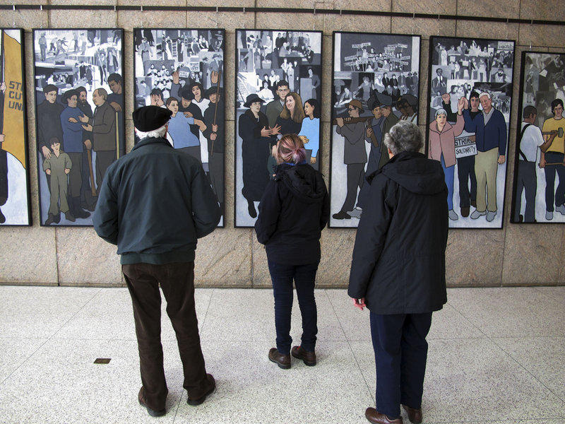 Richard and Pat Bamforth look at a mural depicting Maine's labor history Jan. 14 at the Maine State Museum in Augusta. A reader wonders what has happened to make the mural – which was removed from a state office building in 2011 – suitable for public display once again.