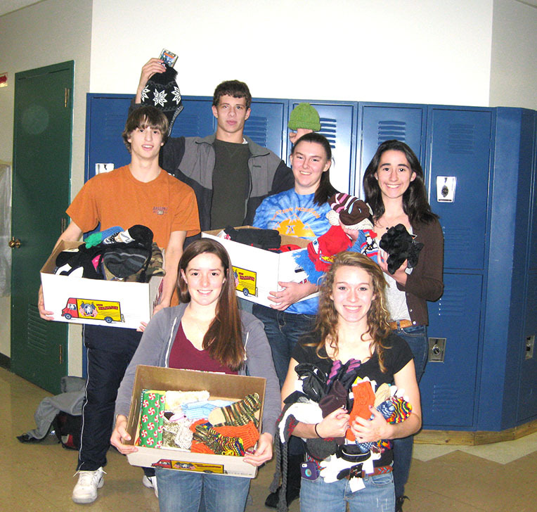 Bonny Eagle High School National Honor Society members, from left, rear, Connor Shields, Ian Smith, Marley Harmon and Gaelyn Lindauer, and from left, front, Natalie Hewitt and Samantha Cox show off hats, mittens and gloves the group purchased to benefit Greater Portland area foster children from Woodfords Foster Services.