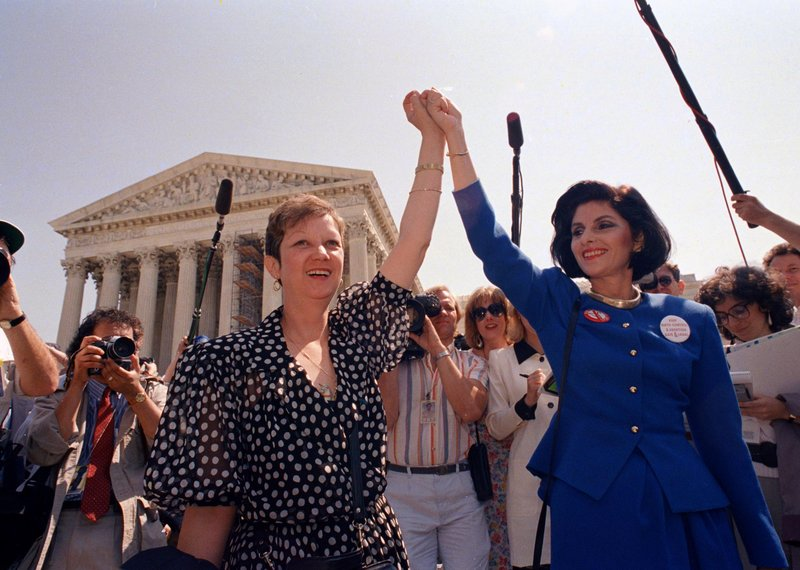 Norma McCorvey, Jane Roe in the 1973 court case, left, and her attorney Gloria Allred leave the Supreme Court building in Washington in 1989 after sitting in while the court heard a Missouri abortion case.