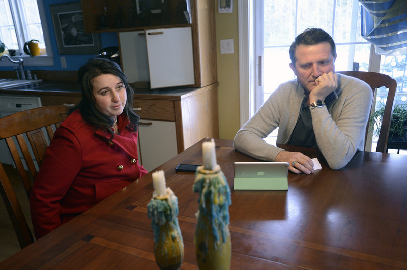 Alla Sherstyukov of Westbrook and her father, Sergey Fisenko, reflect on the life of Margarita Fisenko Scott, 29, Sunday at Sergey's home in Scarborough. Scott, whose body was found Thursday outside a Motel 6, was Sherstyukov's cousin and Fisenko's niece.