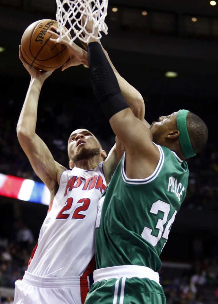 Celtics forward Paul Pierce, right, defends against Pistons forward Tayshaun Prince in the first half of Detroit's 103-88 win on Sunday.