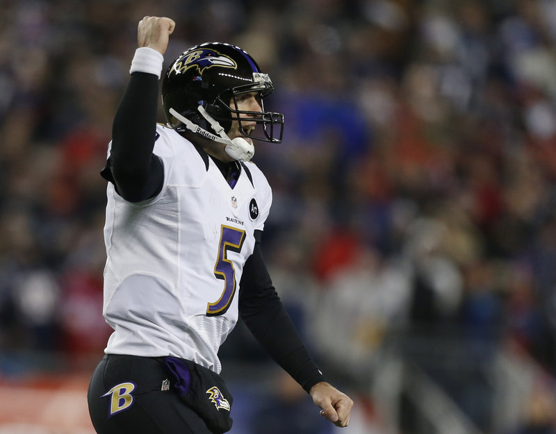 Ravens quarterback Joe Flacco celebrates after his third touchdown pass of the game – an 11-yarder to Anquan Boldin that clinched Baltimore's 28-13 win Sunday over the New England Patriots in the AFC championship game.