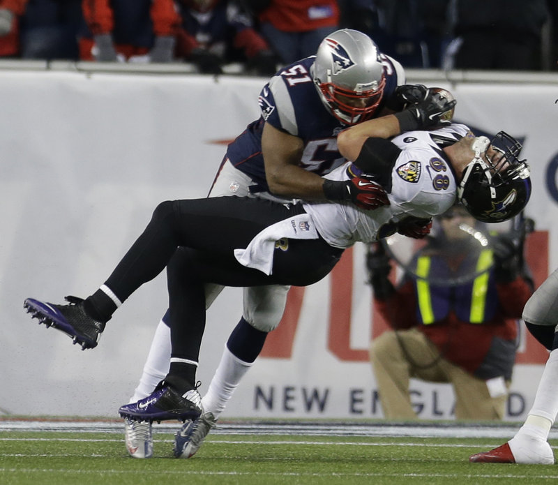Patriots linebacker Jerod Mayo delivers a big hit after a catch by Ravens tight end Dennis Pitta in the third quarter. Pitta recovered quickly and caught the go-ahead touchdown pass on the next play.