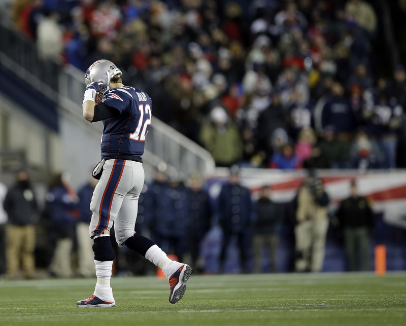 You don't need to be an expert in body language to guess things are not going well for QB Tom Brady as he walks off the field in the second half of Sunday's AFC championship game at Gillette Stadium. Brady and the Pats were shut out in the second half of a 28-13 loss to the Ravens.