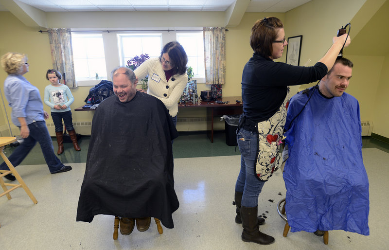 Volunteer Laurie Ferguson of Saco shares a laugh with John Pesaturo Sr. of Old Orchard Beach as she cuts his hair. To the right, Amy DesRoberts of Saco cuts hair for Noah Warner of Biddeford during the First Parish Congregational Church, UCC of Saco, Martin Luther King Jr. Day of Service event Monday, Jan. 21, 2013.