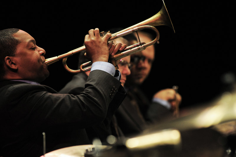 Wynton Marsalis plays as other members of the Jazz at Lincoln Center Orchestra look on. The group has been performing around the world and participating in educational programs for 25 years. They will play a concert at Merrill Auditorium at 8 p.m. Friday as part of their 25th anniversary tour.