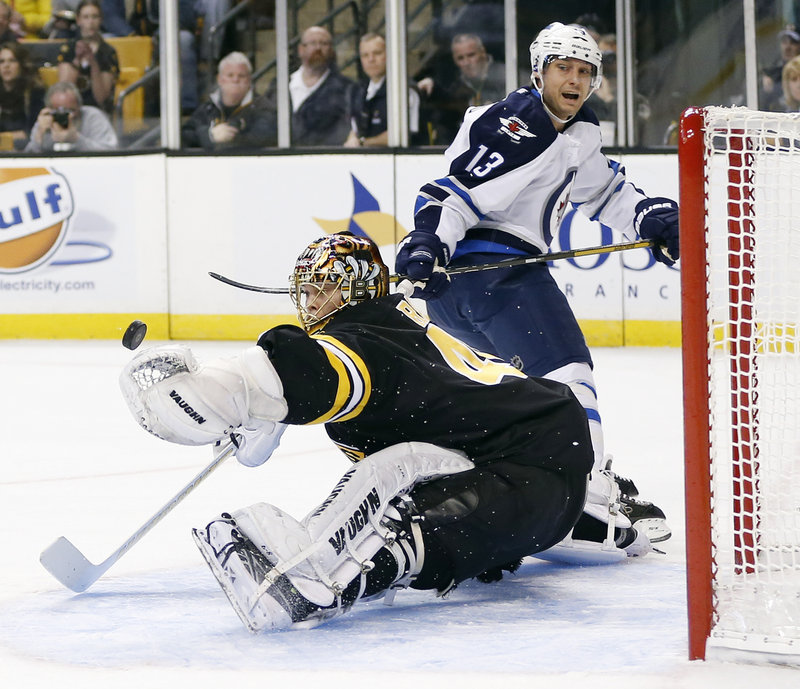 Bruins goalie Tuukka Rask does a split to make a glove save on Winnipeg's Kyle Wellwood Monday. Rask finished with 26 saves.