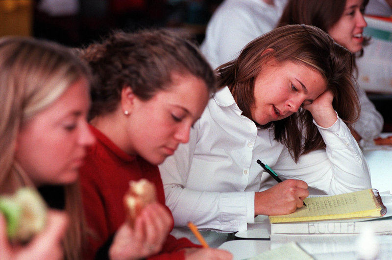"""A Catherine McAuley High School student prepares for a test during lunch period in a 2000 file photo. A McAuley teacher questions a letter that he said """"baselessly denigrates"""" the Portland school."""