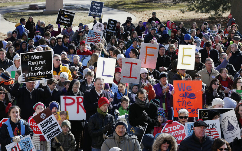 "Abortion foes rally Tuesday outside the Statehouse in Topeka, Kan. Gov. Sam Brownback told the 1,000 or so marchers: ""There's joy in what you're doing and keep it up."""
