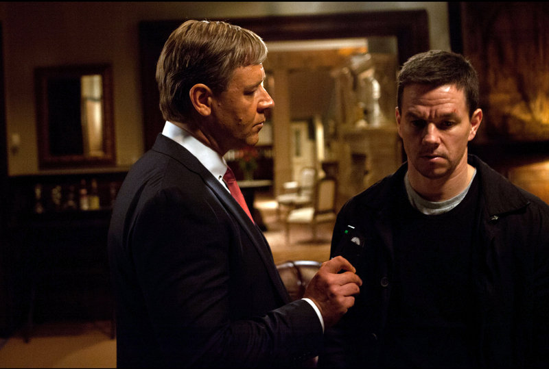 "Russell Crowe, left, and Mark Wahlberg co-star in the crime thriller ""Broken City."""