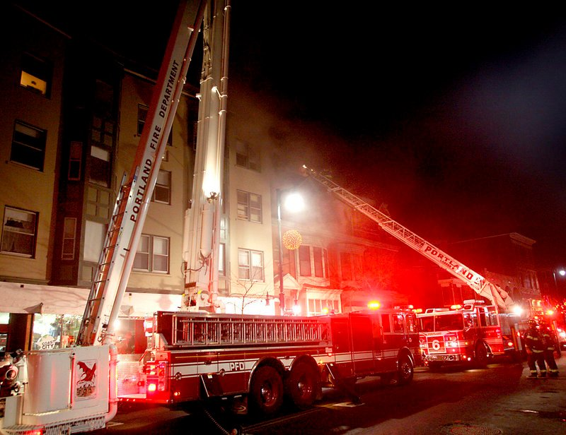 Portland firefighters tackle a blaze at 660 Congress St. on Jan. 14, 2010. Nearly all of the 25 or so Maine fire departments represented by the Professional Firefighters of Maine use a 24-hour-shift schedule.