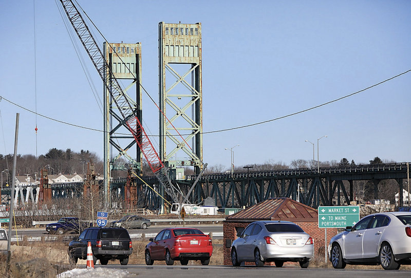 In this photo made Wednesday, Jan. 23, 2013, traffic backs up in Portsmouth, N.H., after the lift span on Sarah Mildred Long Bridge became stuck about a foot from its normal position. Work was started on Thursday to fix the lift bridge between New Hampshire and Maine. (AP Photo/Ioanna Raptis/Seacoastonline)