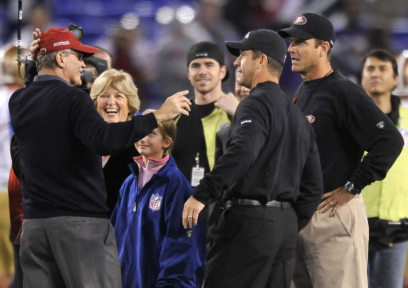 Jack Harbaugh, far left, and his wife, Jackie, second from left, chat with sons John, second from right, and Jim before a Baltimore Ravens-San Francisco 49ers game a season ago. The brothers compete again in the Super Bowl.