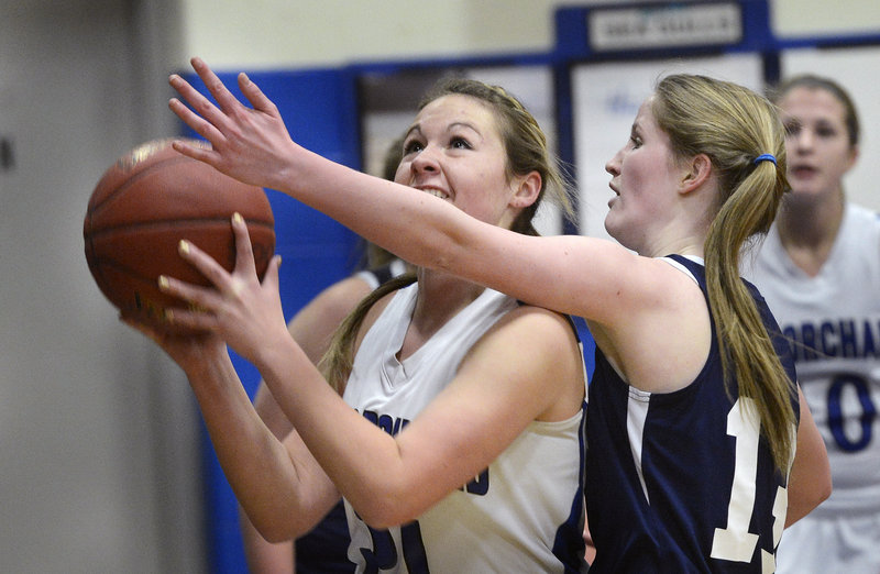 Abby Dubois, who scored 17 points Tuesday for Old Orchard Beach, heads to the basket against Jessica Smith of Greater Portland Christian during their schoolgirl basketball game. Old Orchard improved to 10-4 with a 79-45 victory at home.