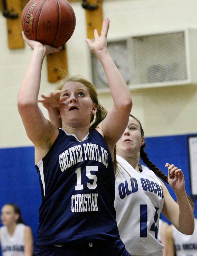 Elaine Beech of Greater Portland Christian gets off a shot as Haley Plante of Old Orchard Beach attempts to knock the ball away.
