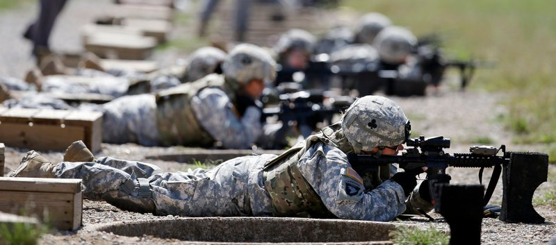 Female soldiers from 1st Brigade Combat Team, 101st Airborne Division train for duty in Afghanistan on a firing range in Fort Campbell, Ky., in September.