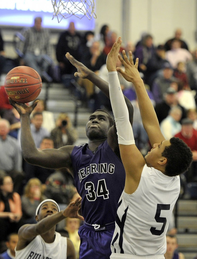 Thiwat Thiwat of Deering has his eyes on the basket while defended by Matt Talbot of Portland, which ended a two-game losing streak – its only two losses of the season. Deering dropped to 12-2.