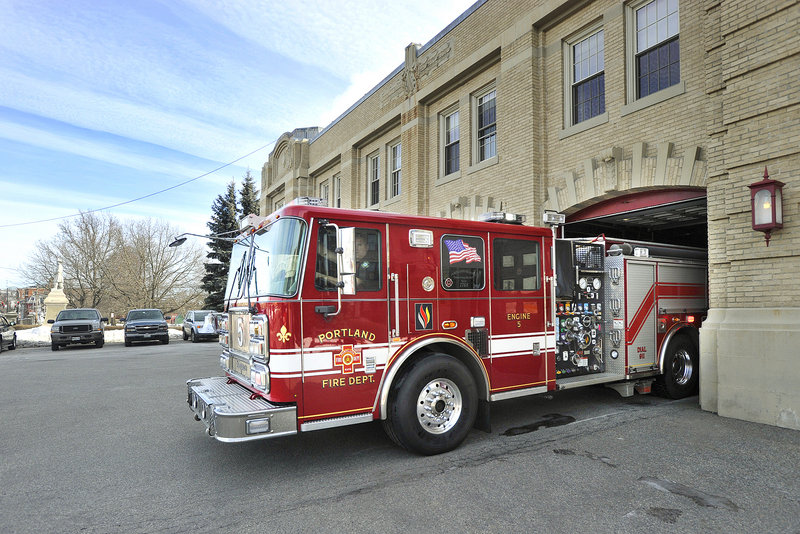 Engine 5 rolls out on a call Friday from the Central Fire Station on Congress Street. Portland employs 234 firefighters in seven stations, not including the fireboat quarters and air rescue unit.
