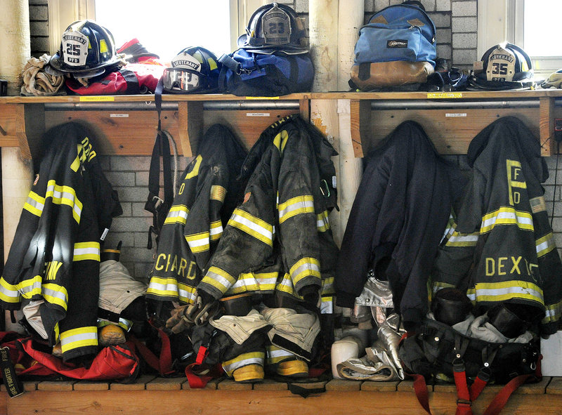 A wall at the station is lined with firefighters' gear.