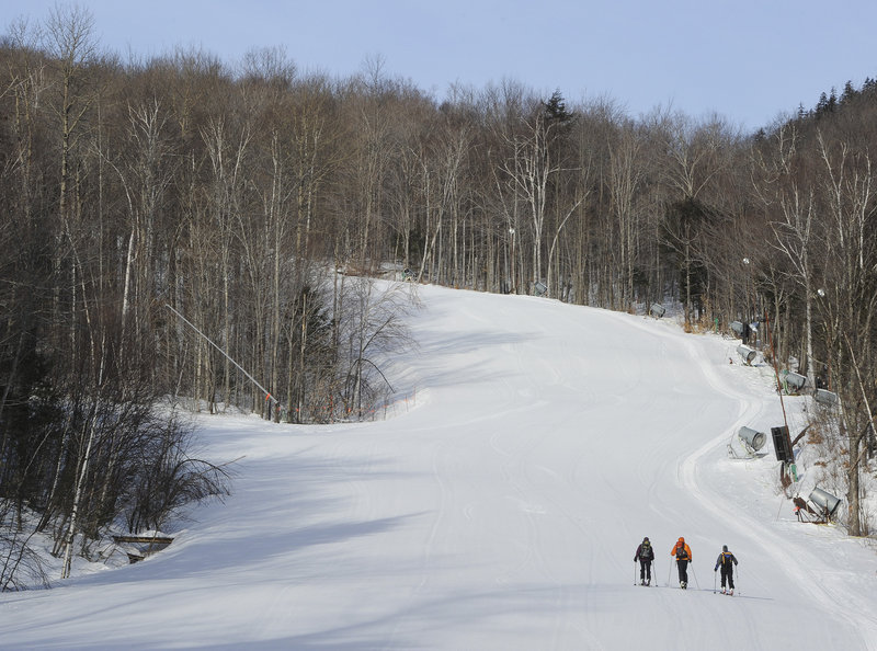It's uphill all the way for Elizabeth Ormiston, Bob Harkins and Callie Pecunies, who get plenty of exercise going up and down the Sunday River slopes. But at least they're not adding to the lift lines and they'll burn a lot of calories before the day – not to mention the ski season – is through.