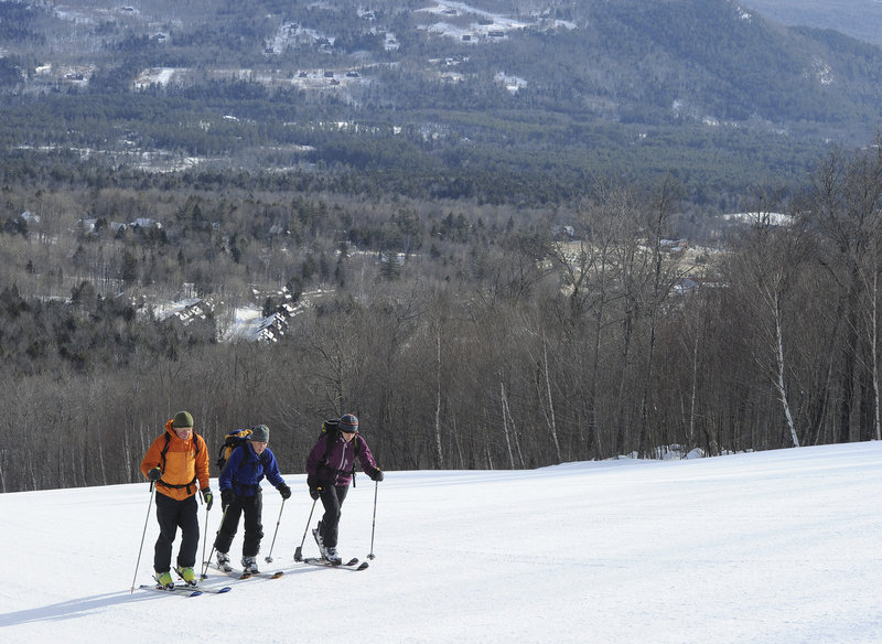 Bob Harkins, left, Callie Pecunies and Elizabeth Ormiston have miles to climb before they can cruise down one of Sunday River's wide trails.