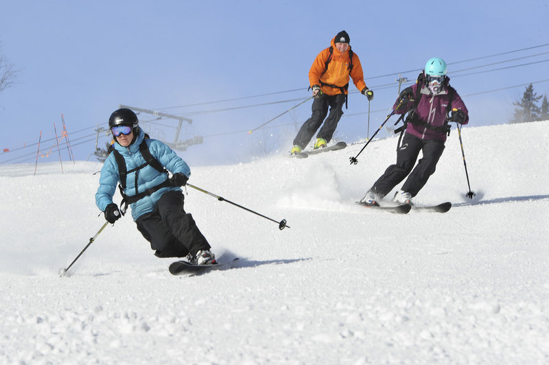 What goes up must come down, and the skiers are glad to let gravity take over after their own strength enabled them to summit.