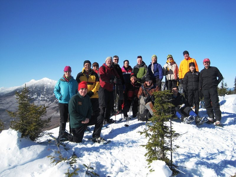 Maine AMC members, shown standing atop Little Bigelow Mountain on a picture-perfect winter's day, find this season invigorating and are always looking for new friends to join their most active chapter of the Appalachian Mountain Club.