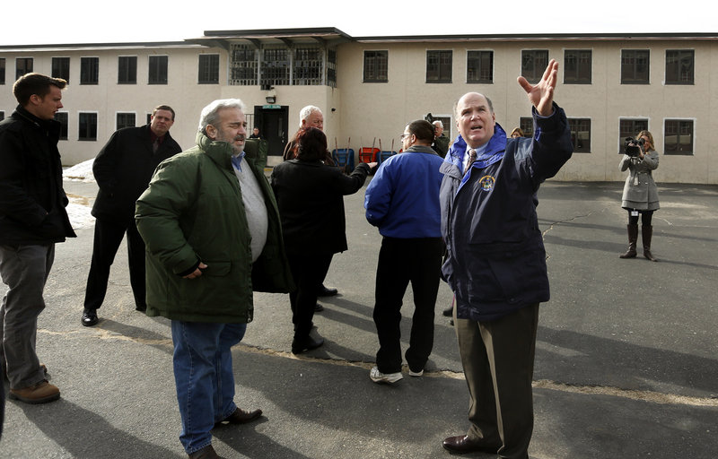 Maine Correctional Center Superintendent Scott Burnheimer, right, leads a tour of the facility Friday for a group of state lawmakers who wanted to see it firsthand. At left is Stan Gerzofsky, D-Brunswick, the Senate chair of the Legislature's Criminal Justice and Public Safety Committee.