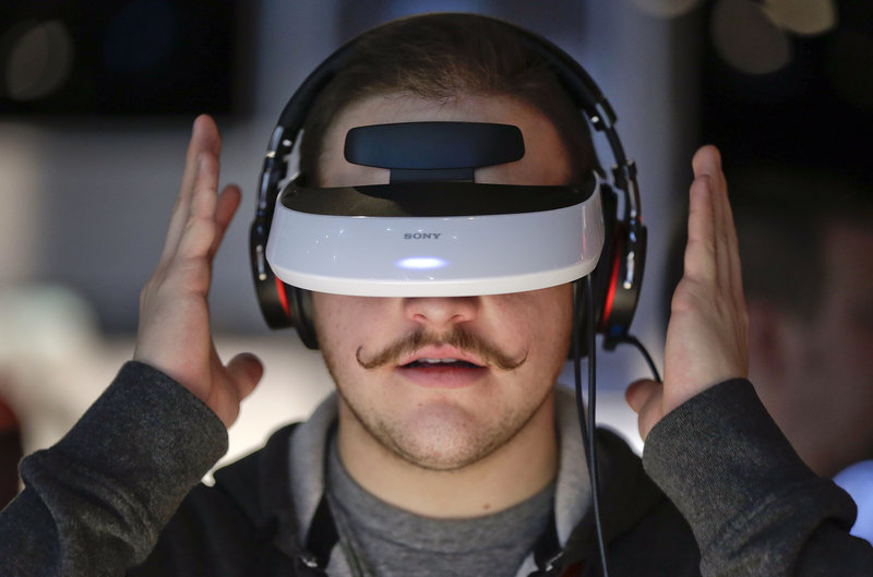 This Sony 3-D personal viewer at the Consumer Electronics Show in Las Vegas is just a high-tech gadget, but may also be seen as a forerunner of much higher-tech automation that replaces jobs now performed by people.