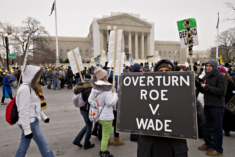Anti-abortion activists march past the U.S. Supreme Court on Friday in Washington, as a large crowd observed the 40th anniversary of the landmark Roe v. Wade decision by marching through the nation's capital.