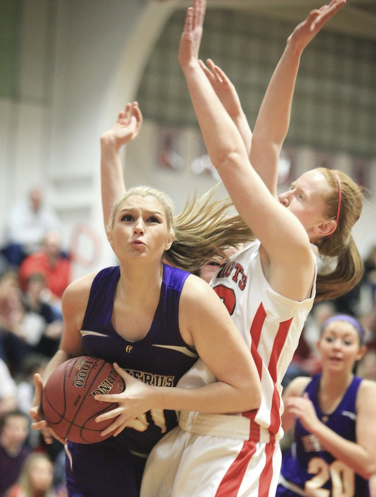 Cassidy Grover tries to get off a shot against South Portland's Hope Owen during Cheverus' 43-33 win Friday.