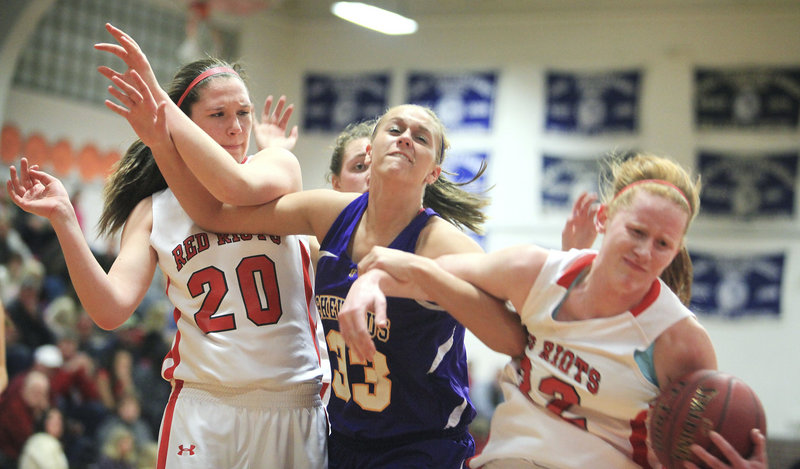 Hope Owen, right, of South Portland tries to protect the ball from Kylie Libby of Cheverus as Meaghan Doyle joins the skirmish Friday night. Cheverus improved to 11-2 with a 43-33 victory.