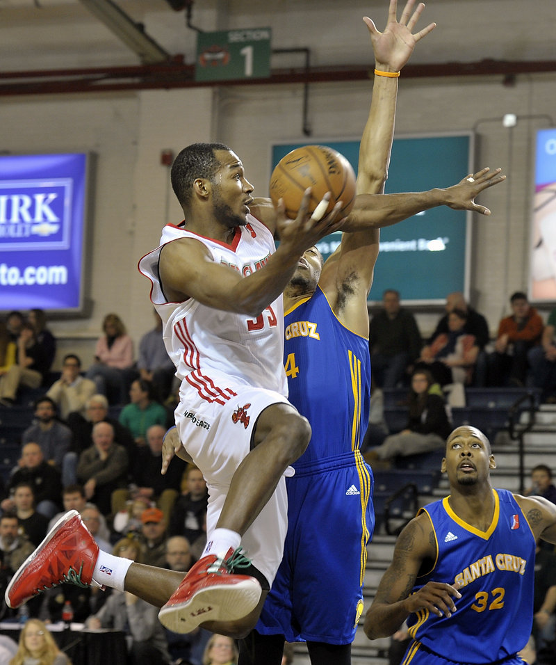 Maine's Chris Wright is obstructed by Santa Cruz's Lance Goulbourne while flying toward the basket in Friday's loss to the Warriors.