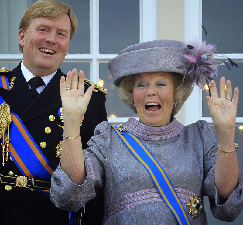 Dutch Queen Beatrix and Dutch Crown Prince Willem-Alexander, left, wave to wellwishers from the balcony of Royal Palace Noordeinde.