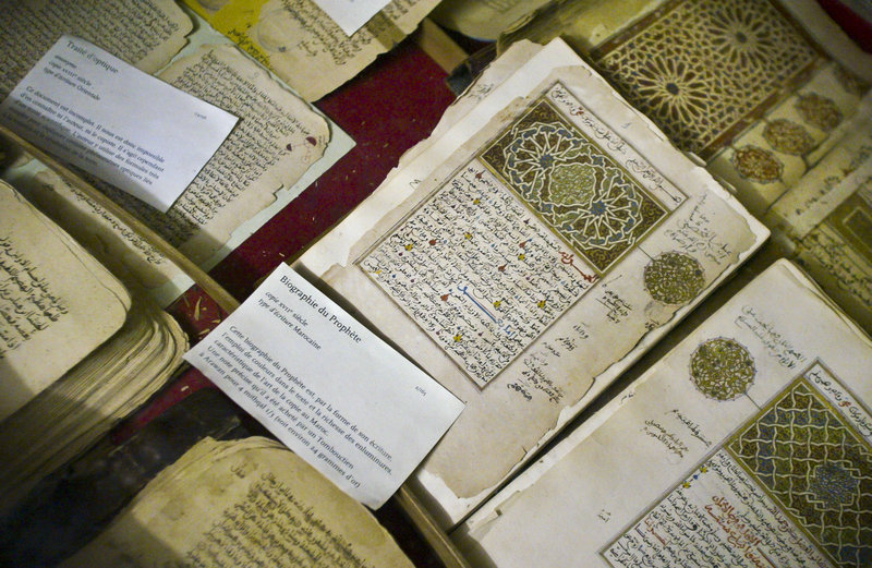 Some of the 20,000 preserved ancient Islamic manuscripts that were displayed at the Ahmed Baba institute in Timbuktu, Mali, are shown. Islamist extremists torched the library containing the manuscripts, the mayor said Monday.