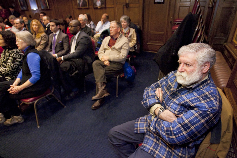 Residents watch as Portland Mayor Michael Brennan gives his first State of the City Address on Monday, Jan. 28, 2013.