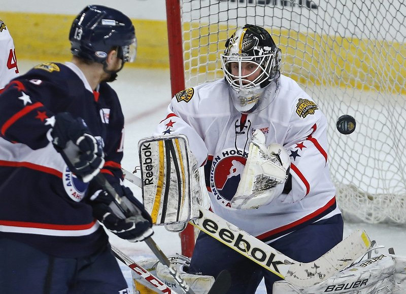 East goalie Niklas Svedberg of the Providence Bruins makes a save on Gustav Nyquist – a former UMaine player – of the Grand Rapids Griffins Monday night in the AHL All-Star game at Providence, R.I. The West won, 7-6.
