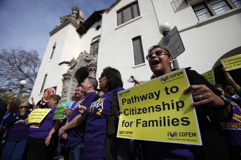 Members of Service Employees International Union chant before President Obama's speech on immigration in Los Angeles on Tuesday.
