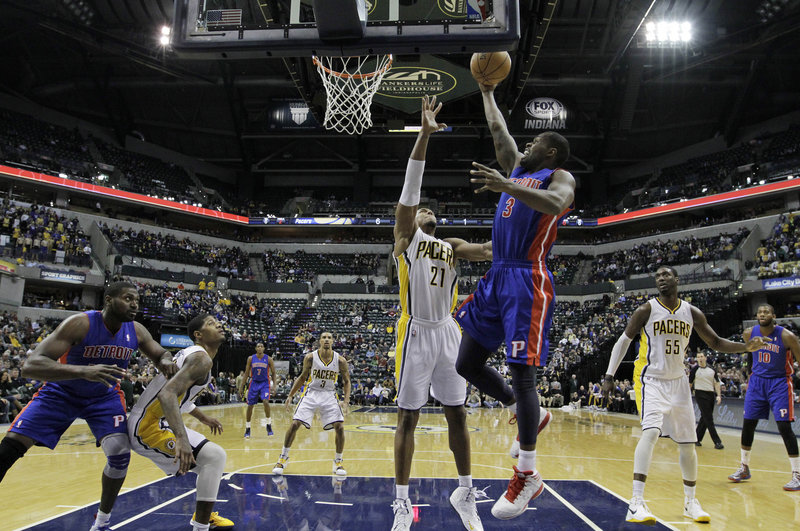 Rodney Stuckey of the Detroit Pistons lifts a shot over David West of the Indiana Pacers during the Pacers' 98-79 victory.