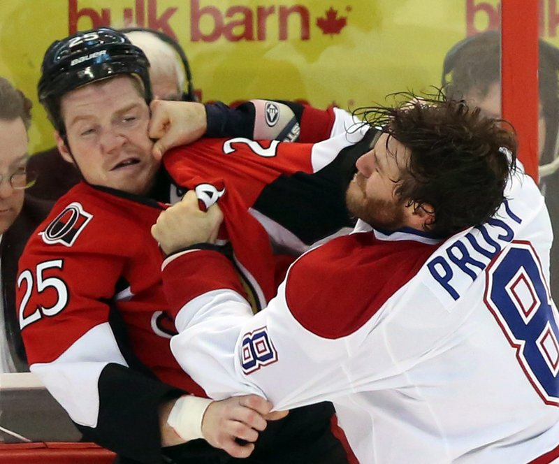 Brandon Proust of Montreal lands a punch to Chris Neil's face in Wednesday night's game at Ottawa. The Senators ended Montreal's four-game winning streak, 5-1.
