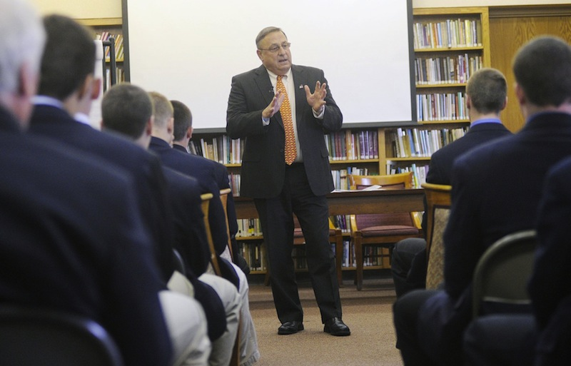 In this May 2012 file photo, Gov. Paul LePage speaks with Cheverus High School students. The LePage administration is proposing a $530,000 school voucher program for low-income students to attend certain private schools or public schools outside of their districts.