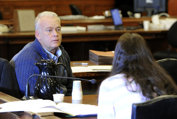 Barry Spencer talks with his wife Paula during the second day of the Spencers' trial for allegedly allowing teens to drink at their home in Falmouth last year.