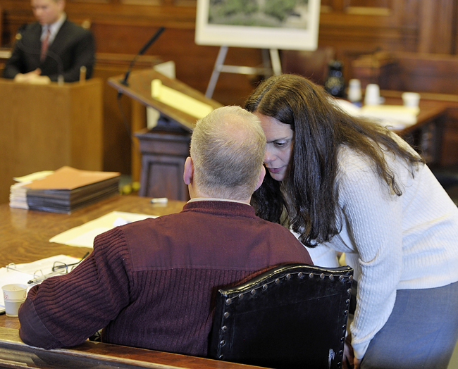 Paula Spencer briefly chats with husband Barry Spencer during a break in the trial on Wednesday.