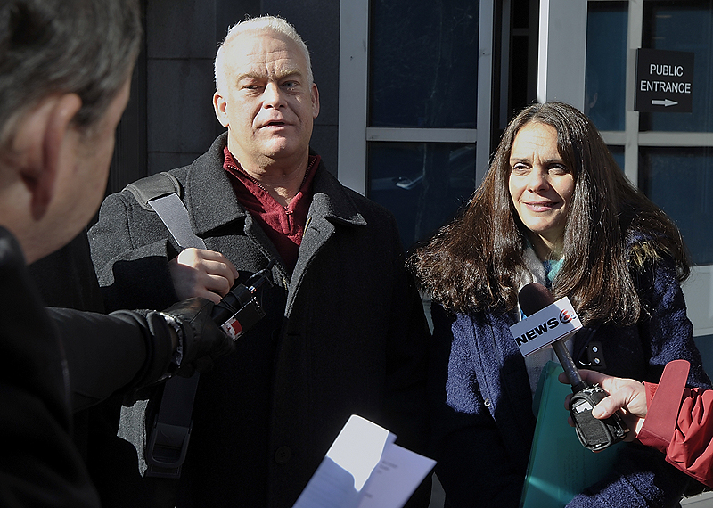 Barry and Paula Spencer, who were charged with letting minors drink at their home, talk to the press outside the Cumberland County Courthouse on Feb. 7 after the jury was unable to reach a verdict in the case.