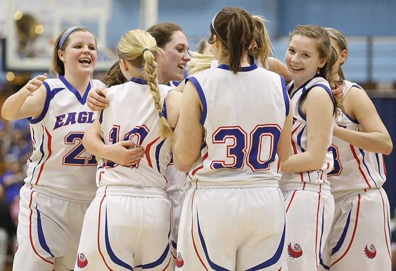 Kristi Willey of Mt. Ararat, left, joins her teammates in celebration after knocking off Oxford Hills in their Class A quarterfinal on Friday.